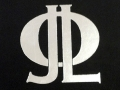 Initials for JLO, Personal embossed silver monogram on hard cover book.