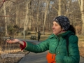 Bronx botanical garden, Woman feeding a bird out of her hand.